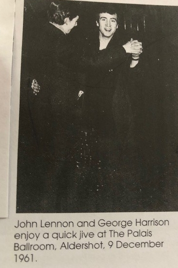 George Harrison and John Lennon dancing together